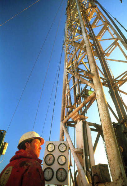 Drilling Photograph - Technician At An Onshore Gas Drilling Rig by Chris Knapton/science Photo Library