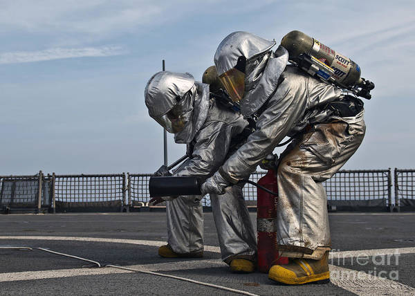 Uss Whidbey Island Photograph - Technicians Check For Hot Spots by Stocktrek Images