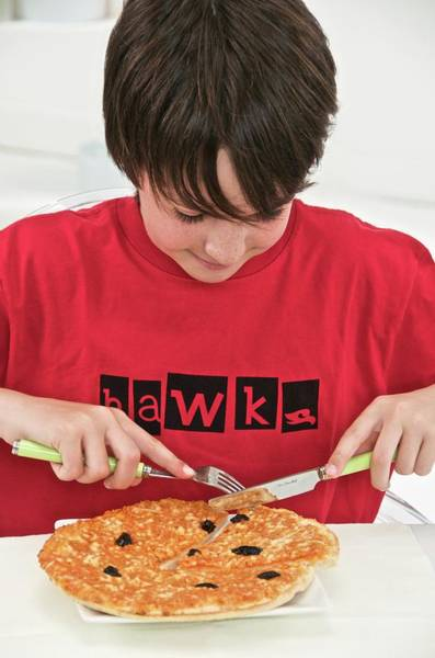 Pizza Photograph - Teenage Boy Eating Pizza by Lea Paterson/science Photo Library