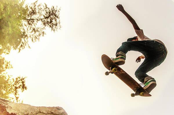 Skateboard Photograph - Teenage Boy Performing Stunt On by @ Mariano Sayno / Husayno.com