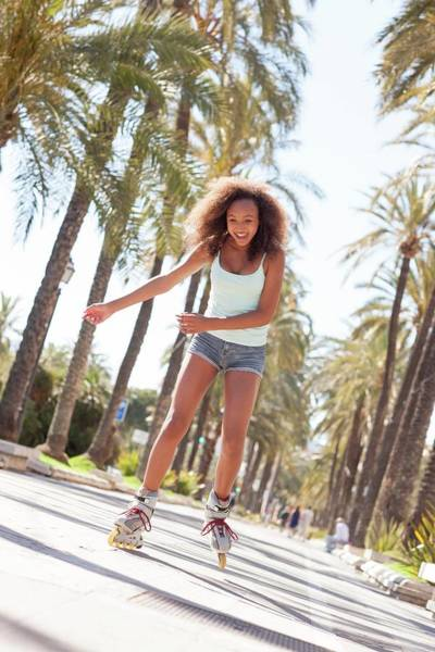 Roller Blades Photograph - Teenage Girl Rollerblading by Ian Hooton/science Photo Library