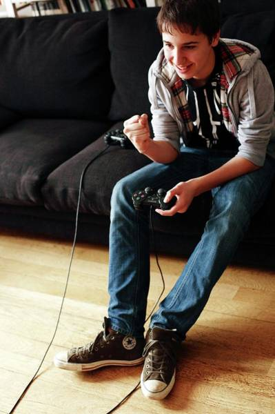 Game Room Photograph - Teenager Playing A Video Game by Mauro Fermariello/science Photo Library