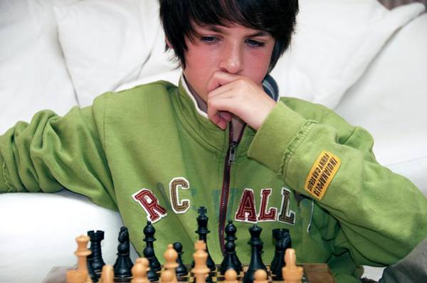 Wall Art - Photograph - Teenager Playing Chess by Lea Paterson/science Photo Library