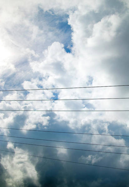 Vertical Line Wall Art - Photograph - Telecommunication Wires Against Storm by Pete Starman