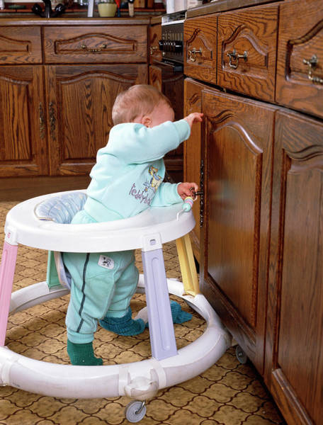 Walkers Photograph - Ten Month Old Baby Using A Baby Walker. by Jim Selby/science Photo Library