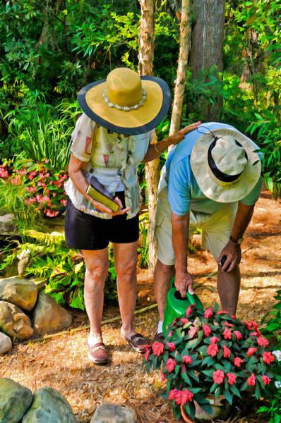 Photograph - Loving Couple Tending Their Garden by Ginger Wakem