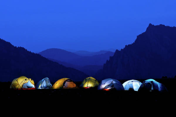 Boulder Mountains Photograph - Tents Illuminated Near Mountains by Celin Serbo