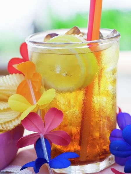 Tequila Sunrise Photograph - Tequila Sunrise With Ice Cubes And Lemon, Tortilla Chips by Foodcollection