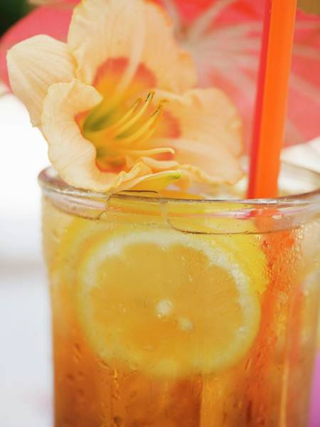 Tequila Sunrise Photograph - Tequila Sunrise With Lemon And Flower by Foodcollection