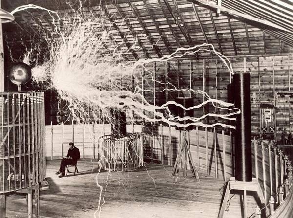 Experimenting Wall Art - Photograph - Tesla Coil Experiment by Nikola Tesla Museum/science Photo Library