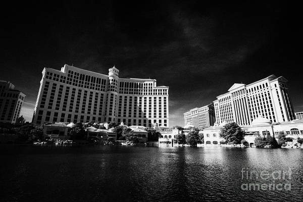 Bellagio Hotel Photograph - the bellagio hotel and casino and caesars palace hotel Las Vegas Nevada USA by Joe Fox
