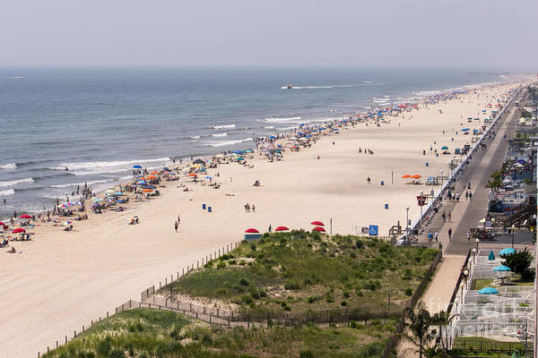 Photograph - The Boardwalk Ends And The Barrier Dune Begins In Ocean City Md by William Kuta
