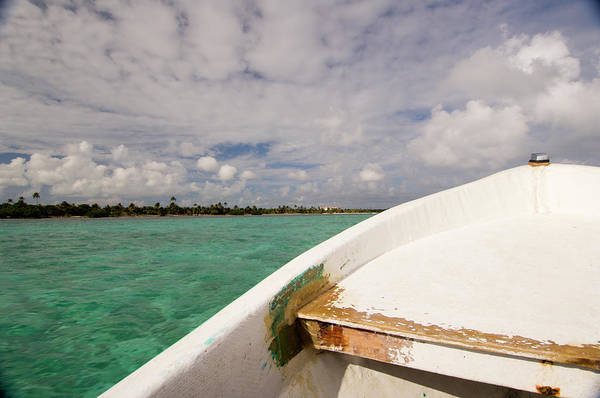 Ambergris Caye Photograph - The Bow Of A Small White Boat by Kevin Steele