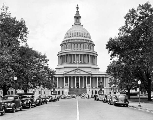 Colonnade Photograph - The Capitol Building by Underwood Archives