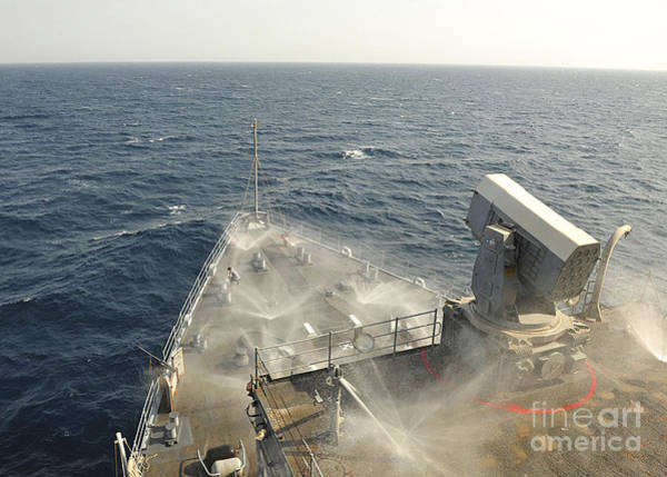 Uss Whidbey Island Photograph - The Countermeasure Wash Down Sprinkler by Stocktrek Images
