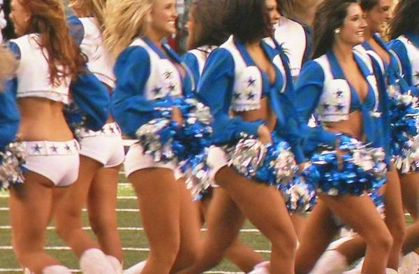 Cheerleaders Photograph - The Dallas Cowboys Cheerleaders by Donna Wilson