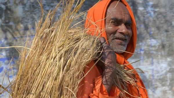 Photograph - The Happy Sadhu - Kumbhla Mela - Allahabad India by Kim Bemis