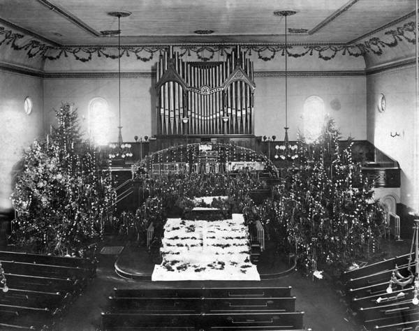 1900 Photograph - The Interior Of A Church Decorated For Christmas. by Underwood Archives