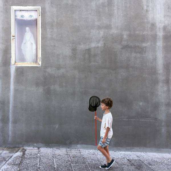 Wall Art - Photograph - The Little Fisherman And The Madonna by Lorenzo Grifantini
