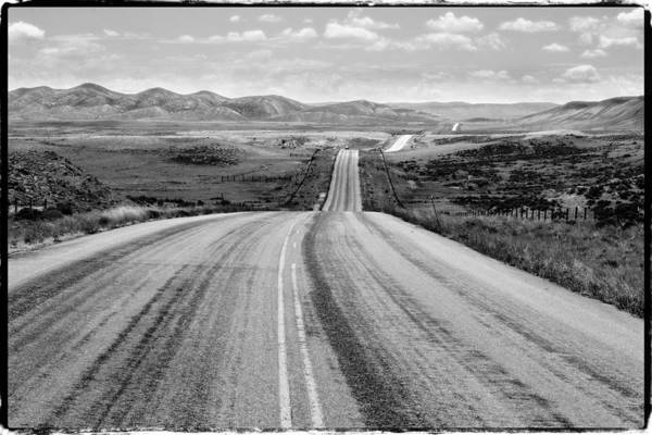 Straight Ahead Wall Art - Photograph - The Long And Lonely Road by John McArthur
