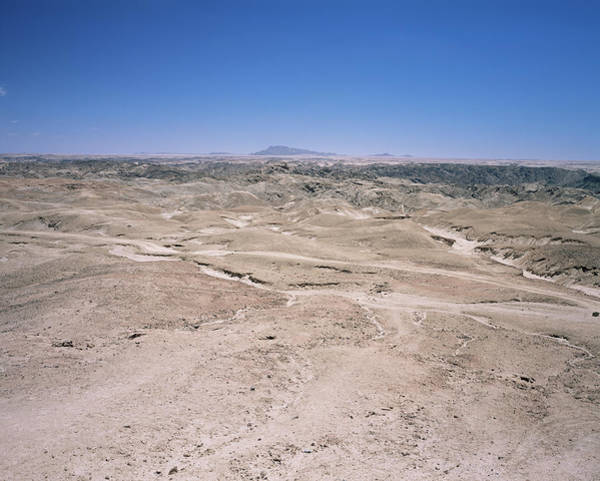 Moonscape Photograph - The Moonscape Desert by Sinclair Stammers/science Photo Library