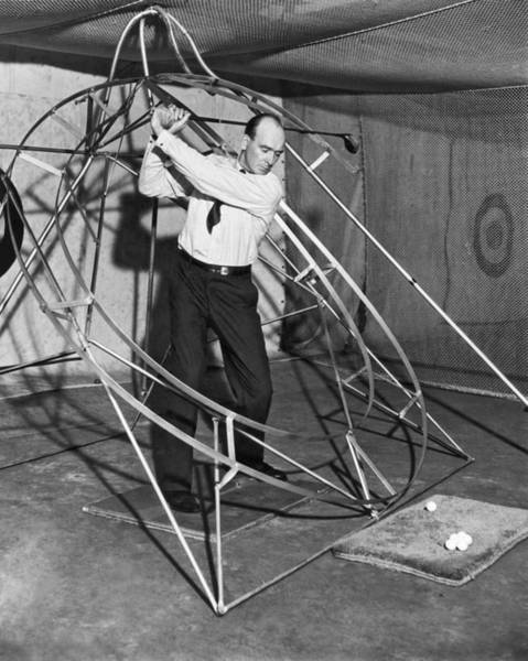 Photograph - The Perfect Swing Device. by Underwood Archives