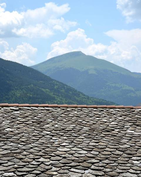 Photograph - The Pyrenees Mountains Over The Rooftops Of Vic by Toby McGuire