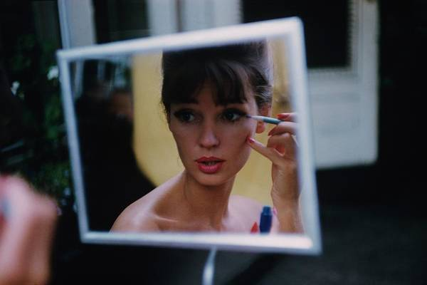 Mirror Photograph - The Reflection Of A Model Applying Make-up by Karen Radkai