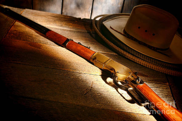 Cowboy Hat Photograph - The Rifle by Olivier Le Queinec