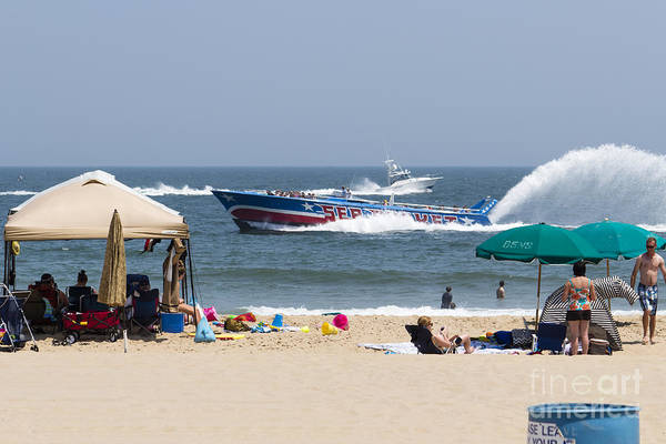 Photograph - The Sea Rocket And A Fishing Boat Pass Close To Shore by William Kuta