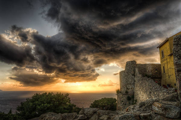 Isola Wall Art - Photograph - The Sunset Storm Over The Castle by Tommaso Di Donato