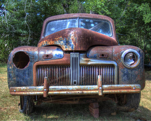 Wrecking Yard Photograph - The Wink by Danny Pickens
