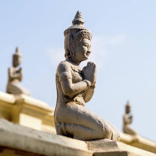 Phnom Penh Wall Art - Photograph - Three Buddha Statues,silver Pagoda by Miha Pavlin