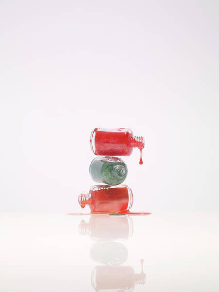 Bottle Green Photograph - Three Kind Of Nail Polish Dripping From by Level1studio