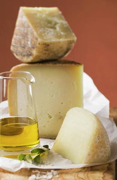 Wall Art - Photograph - Three Pieces Of Cheese, Olive Oil And Salt by Foodcollection