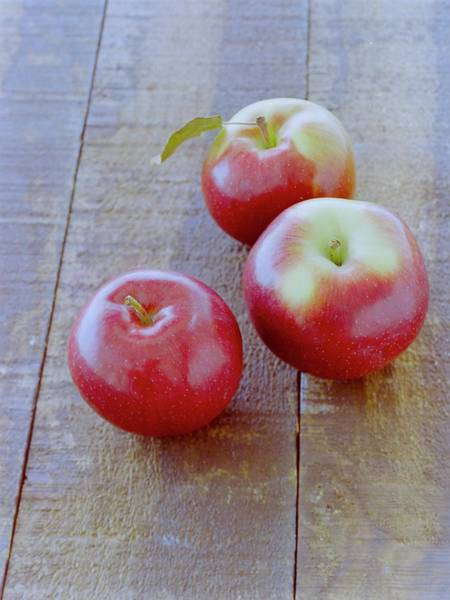 Photograph - Three Red Apples by Romulo Yanes