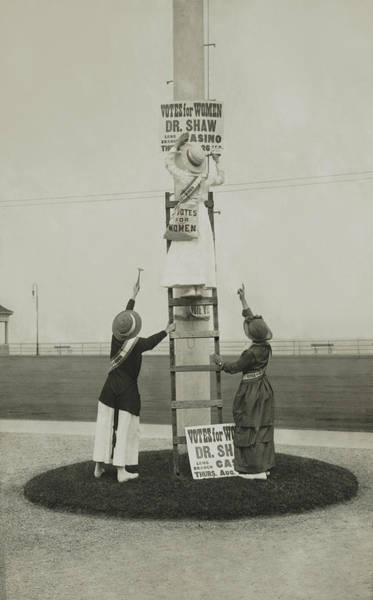 Wall Art - Photograph - Three Women Installing A Sign by Stocktrek Images