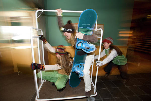 Antic Photograph - Three Women Ride A Hotel Luggage Cart by Woods Wheatcroft