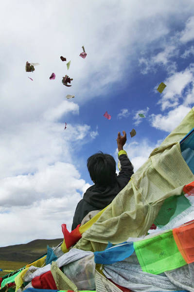 Tibetan Throwing Paper Prayers On A Art Print