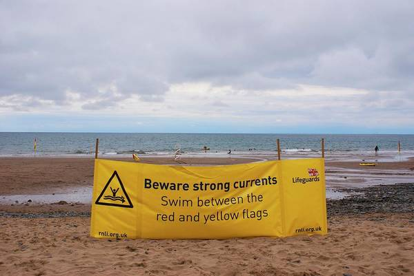 Lifeboat Photograph - Tidal Warning Sign by Mark Williamson
