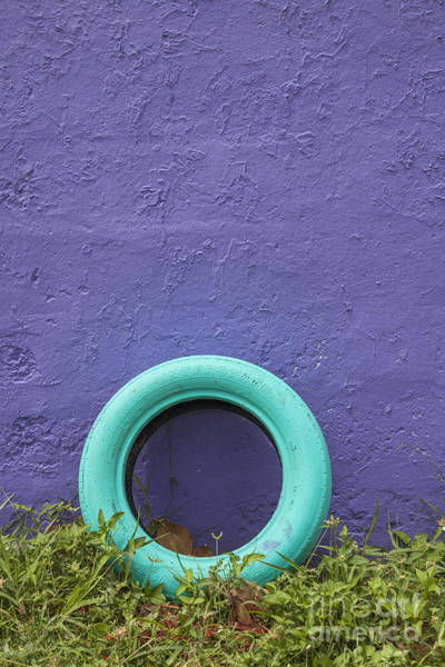 Photograph - Tire Painted In Bright Color Leaning Against Wall In San Juan Pue by Bryan Mullennix