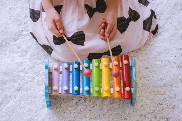 Toddler Playing A Xylophone At Home Art Print by Suphat Bhandharangsri Photography