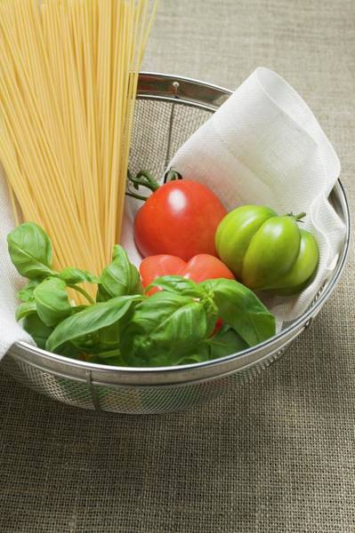 Vegies Photograph - Tomatoes, Spaghetti And Basil In A Sieve by Foodcollection
