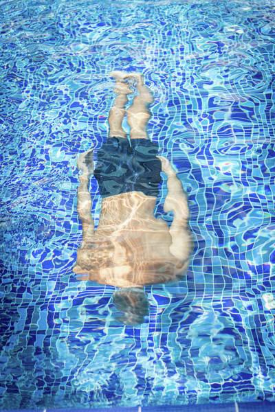 Jasmin Photograph - Top View Of Man Diving by Jasmin Merdan