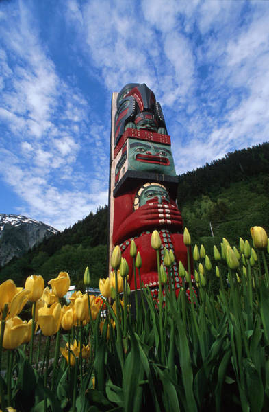 Ice Carving Photograph - Totem Pole With Tulips Juneau Southeast by Randy Brandon
