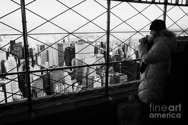 Reach For The Sky Wall Art - Photograph - Tourist In Heavy Coat And Camera Looks At The View From Observation Deck 86th Floor Empire State  by Joe Fox