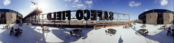 Wall Art - Photograph - Tourist Sitting On A Roof by Panoramic Images