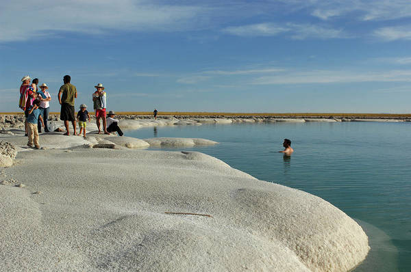 Salar De Atacama Photograph - Tourists At Atacama Salt Lake Near San by Christian Heeb