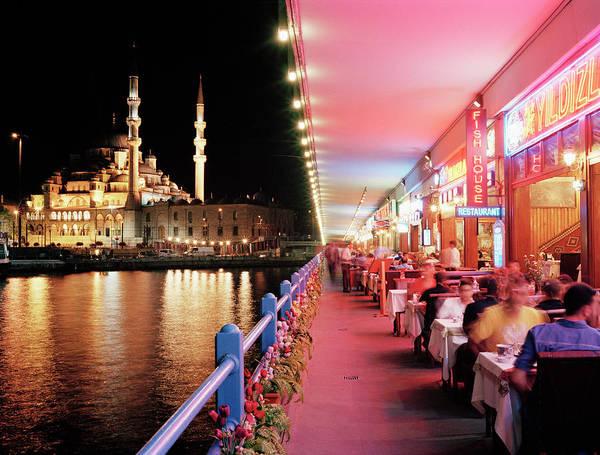 Galata Photograph - Tourists Dining Along Galata Bridge At by Gary Yeowell