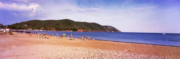 Elba Photograph - Tourists On The Beach, Island Of Elba by Panoramic Images